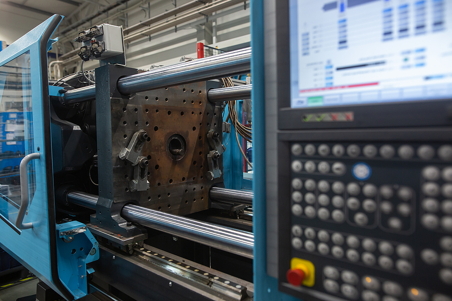 Huge injection molding machine without fixture, ready for the plastic articles by injecting heated material into mold; production